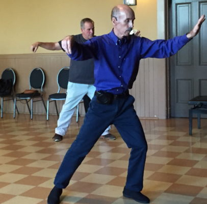 Photos courtesy Michel Czehatowski / Foreground, Michel Czehatowski teaches tai chi.