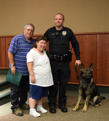 Kelly and Teila Frost with Josh Tracy and Nord the K-9.