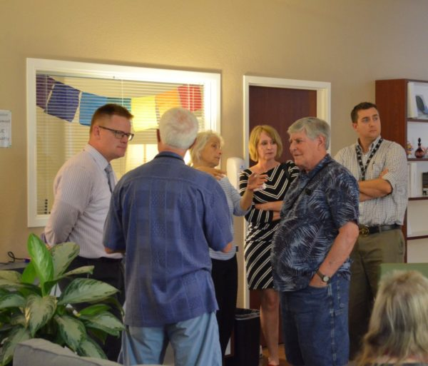 Bruce Ross, center, Assemblyman Brian Dahle's district director, speaks with Shasta County Board of Supervisor Steven Morgan, District 4 (right) and Dr. Jack Kimple, director on the HiIl Country Health and Wellness Clinic Board (left), discuss the new Hill Country Care Center's facility in Redding.