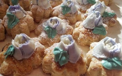 Puff pastry flowers with purple buttercream flowers were among the wedding buffet favorites.