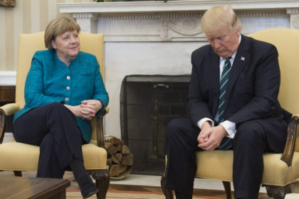 President Trump did not extend his hand to shake German Chancellor Angela Merkel's in a March 2017 Oval Office photo op. New York Post online photo.
