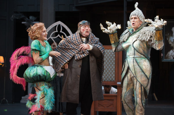Belle's father Maurice (Michael J. Hume, center) is entranced by Lumière (David Kelly, right) and Babette (Robin Goodrin Nordli, left), as Ensemble members (Tatiana Lofton and Shaun Taylor-Corbett) look on. Photo by Jenny Graham, Oregon Shakespeare Festival.