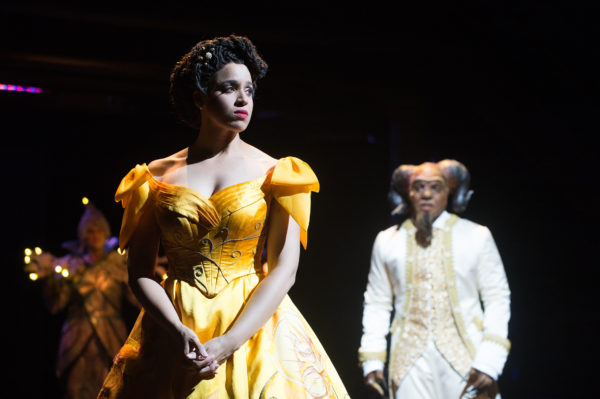 Belle (Jennie Greenberry, left) is wooed by the Beast (Jordan Barbour, right) as Lumière (David Kelly) observes in the background. Photo by Jenny Graham, Oregon Shakespeare Festival.