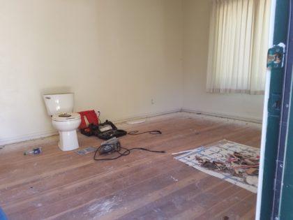 Here's the back bedroom floor before Corey sanded it.