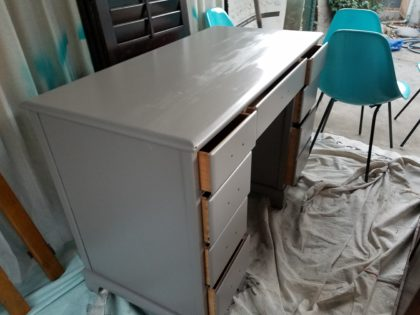 A small can of oops paint transformed this little old desk into the foundation for a kitchen vanity.