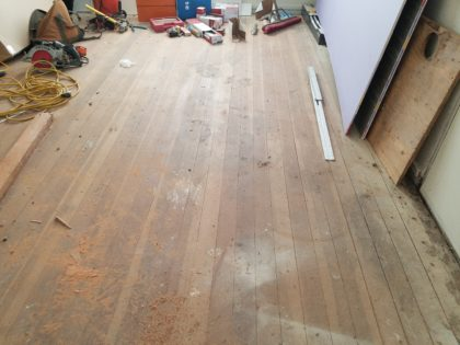 This is what the back bedroom floor looked like before sanding.