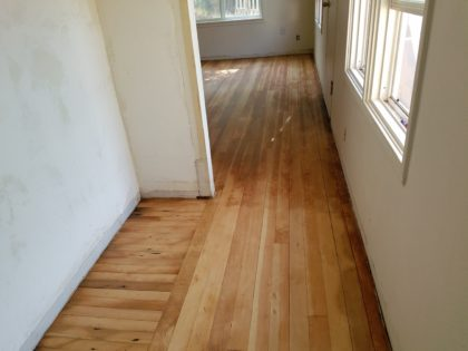 Corey sanded the floors, which will need a few more coats of sealant.