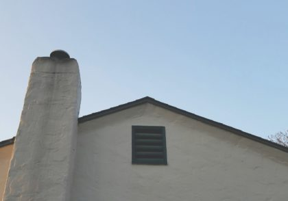 See the retangular wood vent near the roof's peak with the space slats? No screens. Come on in, rats. You're welcome.