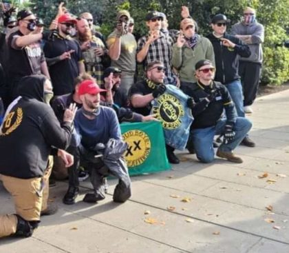 """State of Jefferson Proud Boys, Regular Proud Boys, and Trump Supporters posing in front of the State Capitol in Sacramento while flashing the """"white power"""" hand gesture"""